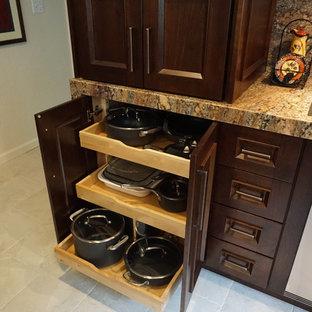 ボストンの大きいアジアンスタイルのおしゃれなキッチン (アンダーカウンターシンク、フラットパネル扉のキャビネット、濃色木目調キャビネット、クオーツストーンカウンター、シルバーの調理設備の、磁器タイルの床、ベージュの床) の写真