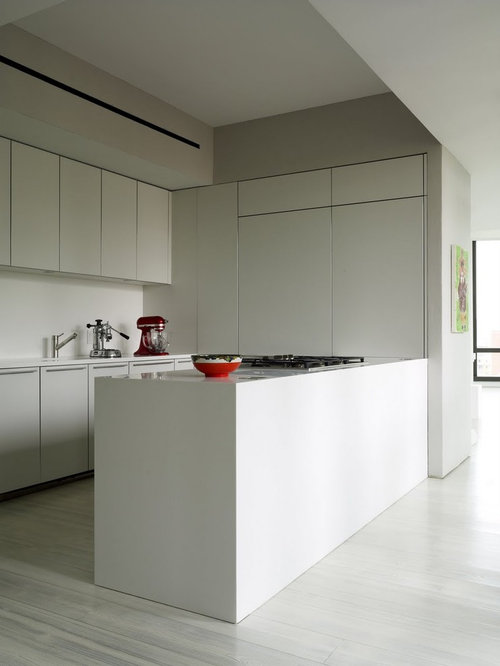 modern kitchen pictures example of a minimalist white floor kitchen design in new york with