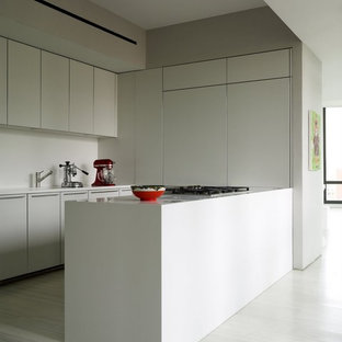 Design ideas for a modern kitchen in New York with flat-panel cabinets, white cabinets and white floor.