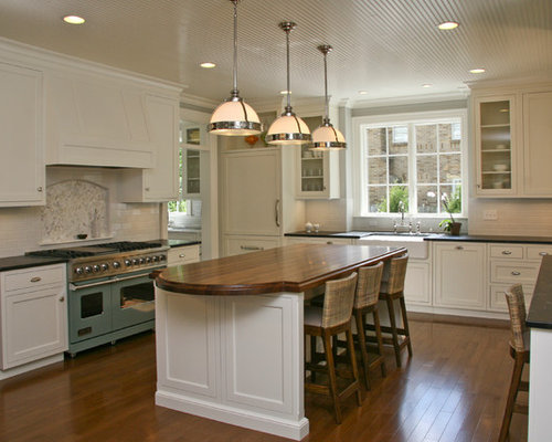 large lshaped eatin kitchen photo in grand rapids with a farmhouse - Vent Hoods