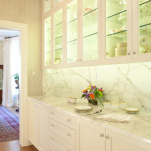 This is an example of a traditional kitchen pantry in Denver with recessed-panel cabinets, white cabinets, white splashback, stone slab splashback and medium hardwood floors.