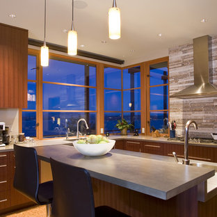 Design ideas for a contemporary l-shaped separate kitchen in Seattle with an undermount sink, flat-panel cabinets, dark wood cabinets, concrete benchtops, grey splashback, stone tile splashback, stainless steel appliances, cork floors and with island.