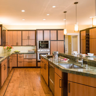 Inspiration for a modern kitchen remodel in San Francisco with granite countertops, stainless steel appliances and green countertops