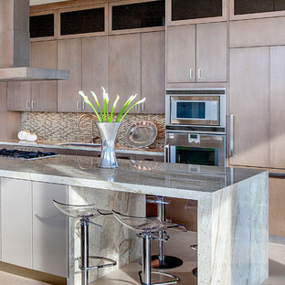 Design ideas for a large contemporary single-wall open plan kitchen in Houston with an undermount sink, flat-panel cabinets, stainless steel appliances, beige cabinets, quartzite benchtops, beige splashback, with island and white floor.