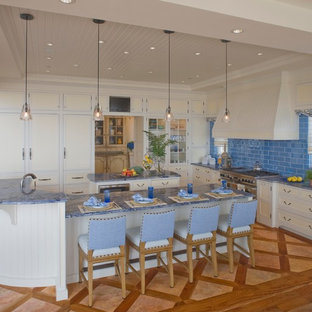Inspiration for a beach style kitchen in Philadelphia with shaker cabinets, white cabinets, blue splashback and blue benchtop.