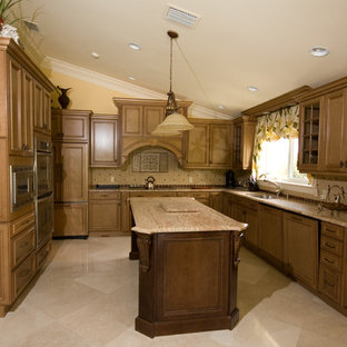 This is an example of a tropical kitchen in Miami with raised-panel cabinets, light wood cabinets, laminate benchtops, beige splashback, ceramic splashback and with island.