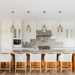 Transitional kitchen in Other with shaker cabinets, white cabinets, grey splashback, stainless steel appliances, light hardwood floors and with island.