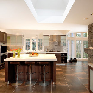 Large contemporary eat-in kitchen designs - Eat-in kitchen - large contemporary single-wall brown floor eat-in kitchen idea in Boston with a farmhouse sink, flat-panel cabinets, dark wood cabinets, metallic backsplash, stainless steel appliances, an island, quartz countertops and white countertops