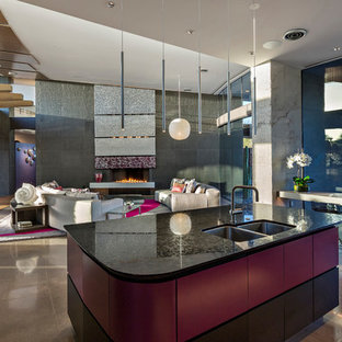 Large contemporary open concept kitchen remodeling - Large trendy concrete floor and gray floor open concept kitchen photo in Phoenix with flat-panel cabinets, granite countertops, an island, black countertops, a double-bowl sink and purple cabinets