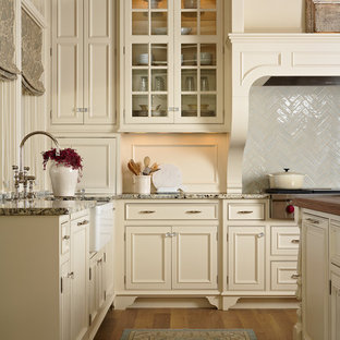 Traditional kitchen in Minneapolis with beaded inset cabinets and beige cabinets.