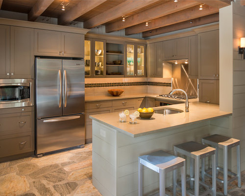 Ex&le of a classic u-shaped kitchen design in Philadelphia with stainless steel appliances & Low Voltage Cable Lights | Houzz azcodes.com