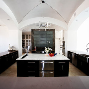 Example of a trendy kitchen design in Dallas with a farmhouse sink, flat-panel cabinets and black cabinets