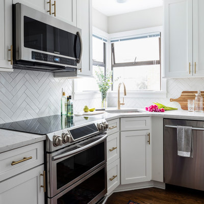 Small arts and crafts medium tone wood floor and brown floor kitchen photo in Seattle with an undermount sink, shaker cabinets, white cabinets, quartz countertops, white backsplash, ceramic backsplash and stainless steel appliances