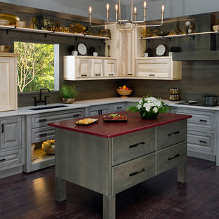Inspiration for a mid-sized midcentury l-shaped kitchen in St Louis with an undermount sink, recessed-panel cabinets, distressed cabinets, brown splashback, timber splashback, stainless steel appliances, dark hardwood floors, with island, brown floor and grey benchtop.