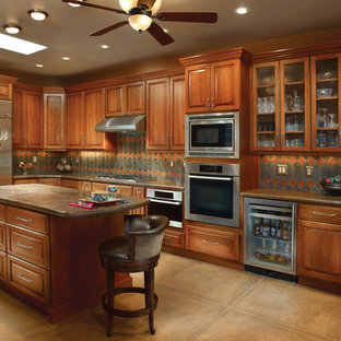 Large traditional eat-in kitchen ideas - Large elegant u-shaped concrete floor and beige floor eat-in kitchen photo in Phoenix with an undermount sink, raised-panel cabinets, medium tone wood cabinets, granite countertops, multicolored backsplash, ceramic backsplash, stainless steel appliances and an island