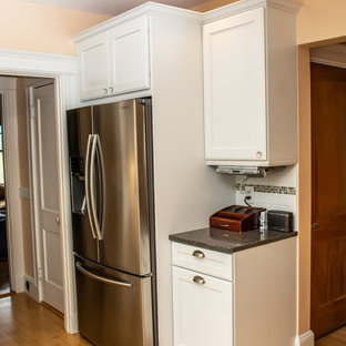Mid-sized traditional eat-in kitchen appliance - Inspiration for a mid-sized timeless u-shaped light wood floor and beige floor eat-in kitchen remodel in Boston with white cabinets, quartz countertops, white backsplash, subway tile backsplash, stainless steel appliances, gray countertops, an undermount sink, recessed-panel cabinets and a peninsula