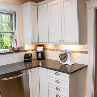 Mid-sized traditional eat-in kitchen photos - Mid-sized elegant u-shaped light wood floor and beige floor eat-in kitchen photo in Boston with white cabinets, quartz countertops, white backsplash, subway tile backsplash, stainless steel appliances, gray countertops, an undermount sink, recessed-panel cabinets and a peninsula