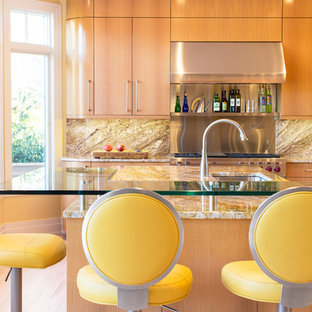 Photo of a contemporary kitchen in Baltimore with a submerged sink, flat-panel cabinets, medium wood cabinets, stainless steel appliances, an island and yellow worktops.