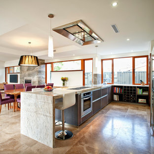 Design ideas for a mid-sized contemporary u-shaped open plan kitchen in Perth with flat-panel cabinets, dark wood cabinets, marble benchtops, stainless steel appliances, travertine floors and beige benchtop.