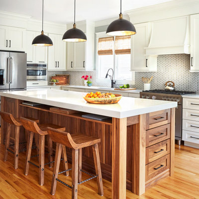 Mid-sized country l-shaped medium tone wood floor and brown floor open concept kitchen photo in DC Metro with an undermount sink, shaker cabinets, white cabinets, quartz countertops, gray backsplash, porcelain backsplash, stainless steel appliances, an island and white countertops