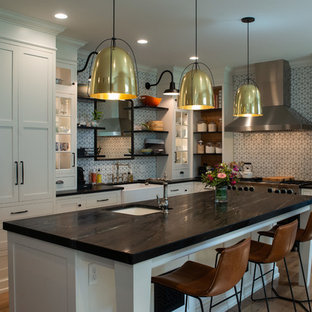 Photo of an eclectic l-shaped kitchen in Philadelphia with soapstone benchtops and black benchtop.