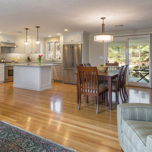 Mid-sized transitional eat-in kitchen appliance - Mid-sized transitional l-shaped medium tone wood floor eat-in kitchen photo in Boston with an undermount sink, recessed-panel cabinets, white cabinets, quartz countertops, green backsplash, ceramic backsplash, stainless steel appliances and an island