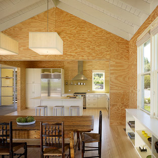 Country l-shaped eat-in kitchen in San Francisco with yellow splashback and stainless steel appliances.