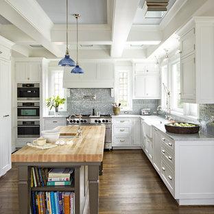ポートランドのトラディショナルスタイルのおしゃれなキッチン (シルバーの調理設備、木材カウンター) の写真