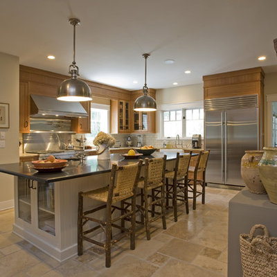 Example of a large mountain style l-shaped ceramic tile enclosed kitchen design in New York with stainless steel appliances, a farmhouse sink, flat-panel cabinets, medium tone wood cabinets, granite countertops, white backsplash and subway tile backsplash