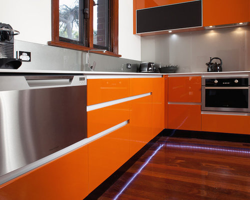 ... , Renovations & Photos with Orange Cabinets and Composite Countertops