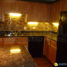 Modern Kitchen by Earthgroup Construction and Remodeling