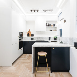 Inspiration for a small contemporary u-shaped kitchen in London with flat-panel cabinets, marble worktops, marble splashback, stainless steel appliances, light hardwood flooring, a breakfast bar, beige floors, grey worktops, a submerged sink, black cabinets and grey splashback.