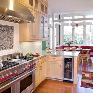 Small victorian eat-in kitchen appliance - Example of a small ornate light wood floor and beige floor eat-in kitchen design in Boston with stainless steel appliances, shaker cabinets, light wood cabinets, granite countertops, white backsplash, subway tile backsplash, a peninsula and gray countertops