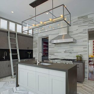 This is an example of a mid-sized contemporary single-wall eat-in kitchen in Atlanta with an undermount sink, flat-panel cabinets, grey cabinets, stainless steel appliances, marble floors, with island, grey splashback, stone tile splashback, solid surface benchtops and grey floor.