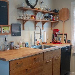 シアトルのエクレクティックスタイルのおしゃれなキッチン (木材カウンター、ドロップインシンク) の写真