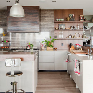 This is an example of a mid-sized contemporary l-shaped kitchen in Vancouver with a double-bowl sink, open cabinets, medium wood cabinets, stainless steel appliances, with island, stone slab splashback, porcelain floors and brown floor.