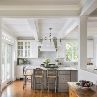 Large coastal enclosed kitchen ideas - Inspiration for a large coastal l-shaped medium tone wood floor and brown floor enclosed kitchen remodel in Salt Lake City with recessed-panel cabinets, ceramic backsplash, stainless steel appliances, white countertops, an undermount sink, gray cabinets, marble countertops, gray backsplash and an island