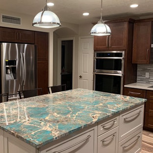 Photo of a mid-sized transitional u-shaped eat-in kitchen in Phoenix with a drop-in sink, shaker cabinets, white cabinets, granite benchtops, multi-coloured splashback, glass tile splashback, stainless steel appliances, porcelain floors, multi-coloured floor, turquoise benchtop and with island.