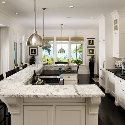 Large elegant galley dark wood floor eat-in kitchen photo in Grand Rapids with recessed-panel cabinets, white cabinets and marble countertops