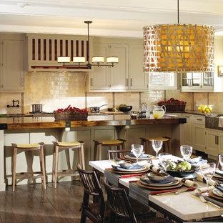 ニューヨークの大きいアジアンスタイルのおしゃれなキッチン (エプロンフロントシンク、インセット扉のキャビネット、ベージュのキャビネット、木材カウンター、ベージュキッチンパネル、セラミックタイルのキッチンパネル、パネルと同色の調理設備、無垢フローリング) の写真