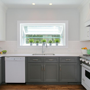 Small transitional enclosed kitchen appliance - Example of a small transitional u-shaped dark wood floor enclosed kitchen design in Chicago with an undermount sink, shaker cabinets, white cabinets, quartz countertops, white backsplash, subway tile backsplash, white appliances and no island