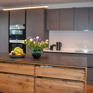Mid-sized scandinavian kitchen remodeling - Mid-sized danish medium tone wood floor and purple floor kitchen photo in Surrey with an island