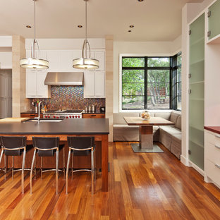 Large transitional eat-in kitchen appliance - Example of a large transitional u-shaped medium tone wood floor eat-in kitchen design in Austin with a single-bowl sink, shaker cabinets, white cabinets, multicolored backsplash, mosaic tile backsplash, stainless steel appliances and an island