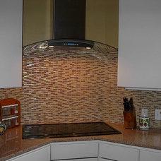 Modern Kitchen by Quality Renovations
