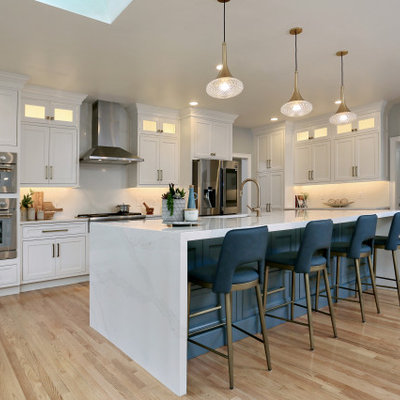 Huge transitional u-shaped medium tone wood floor eat-in kitchen photo in Boston with an undermount sink, beaded inset cabinets, white cabinets, quartz countertops, white backsplash, quartz backsplash, stainless steel appliances, an island and white countertops