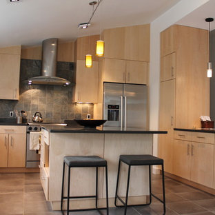 Photo of a contemporary u-shaped kitchen in Boston with flat-panel cabinets, light wood cabinets and slate splashback.