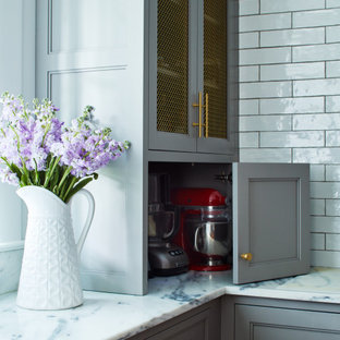 Design ideas for a large country u-shaped kitchen pantry in New York with recessed-panel cabinets, grey cabinets, marble worktops, black splashback, ceramic splashback, medium hardwood flooring, an island, brown floors and brown worktops.