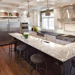 Eat-in kitchen - transitional l-shaped eat-in kitchen idea in Cincinnati with a farmhouse sink, raised-panel cabinets, white cabinets, white backsplash, subway tile backsplash and stainless steel appliances