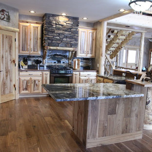 Inspiration for a country eat-in kitchen in Chicago with louvered cabinets, light wood cabinets, onyx benchtops, medium hardwood floors and with island.
