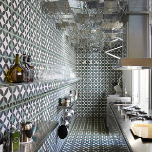 Inspiration for an eclectic galley kitchen in London with stainless steel benchtops and no island.